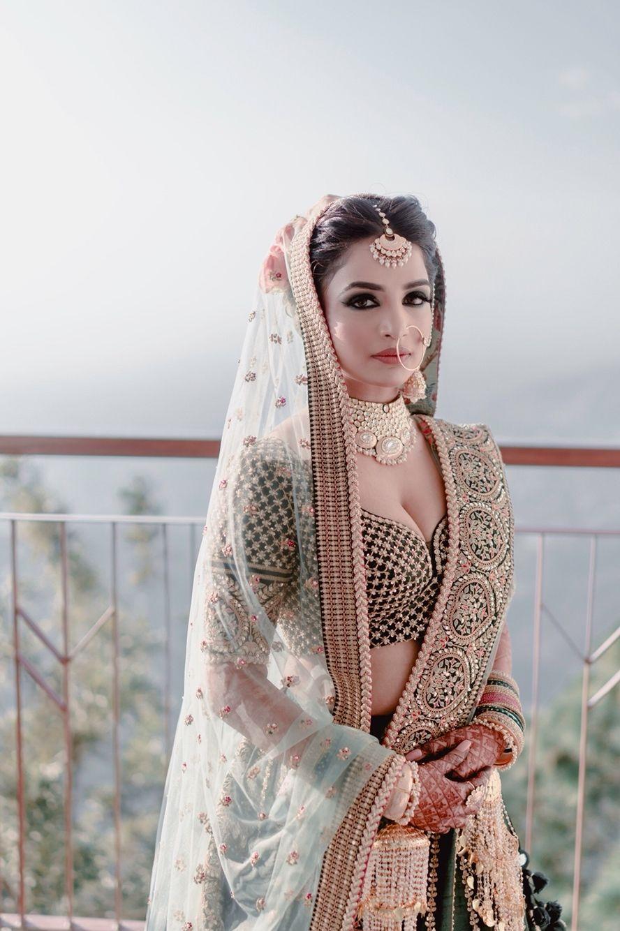 Photo of Teal bridal sabya lehenga with smokey eyes
