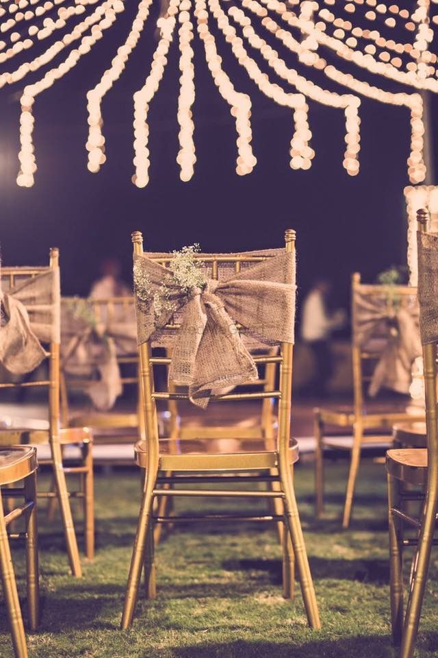 Photo of wooden chairs with burlap cloth