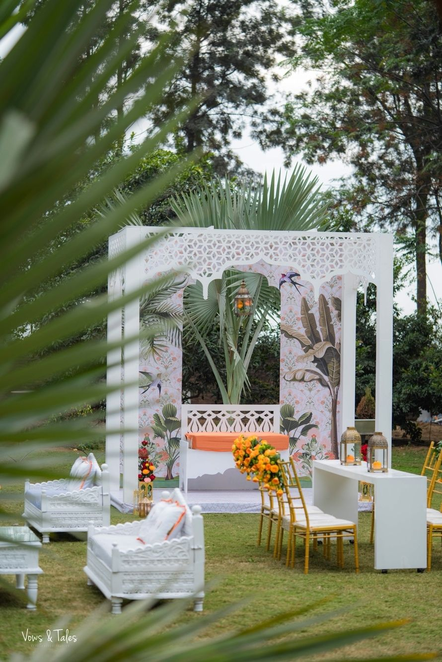 Photo of Mehendi or wedding decor with all white mandap