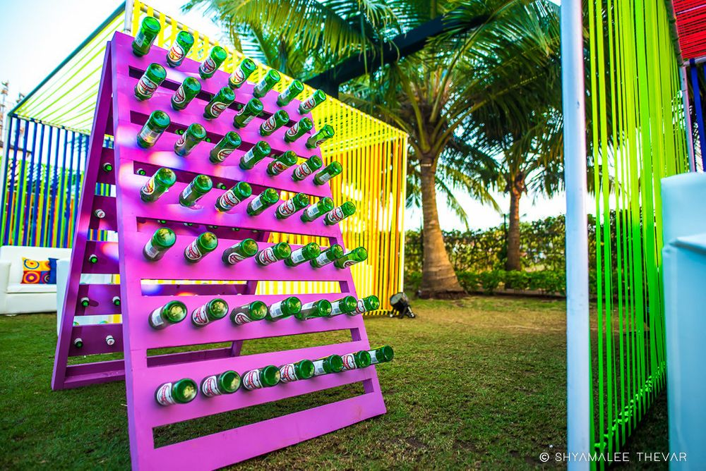 Photo of Unique decor idea with bottles on stand