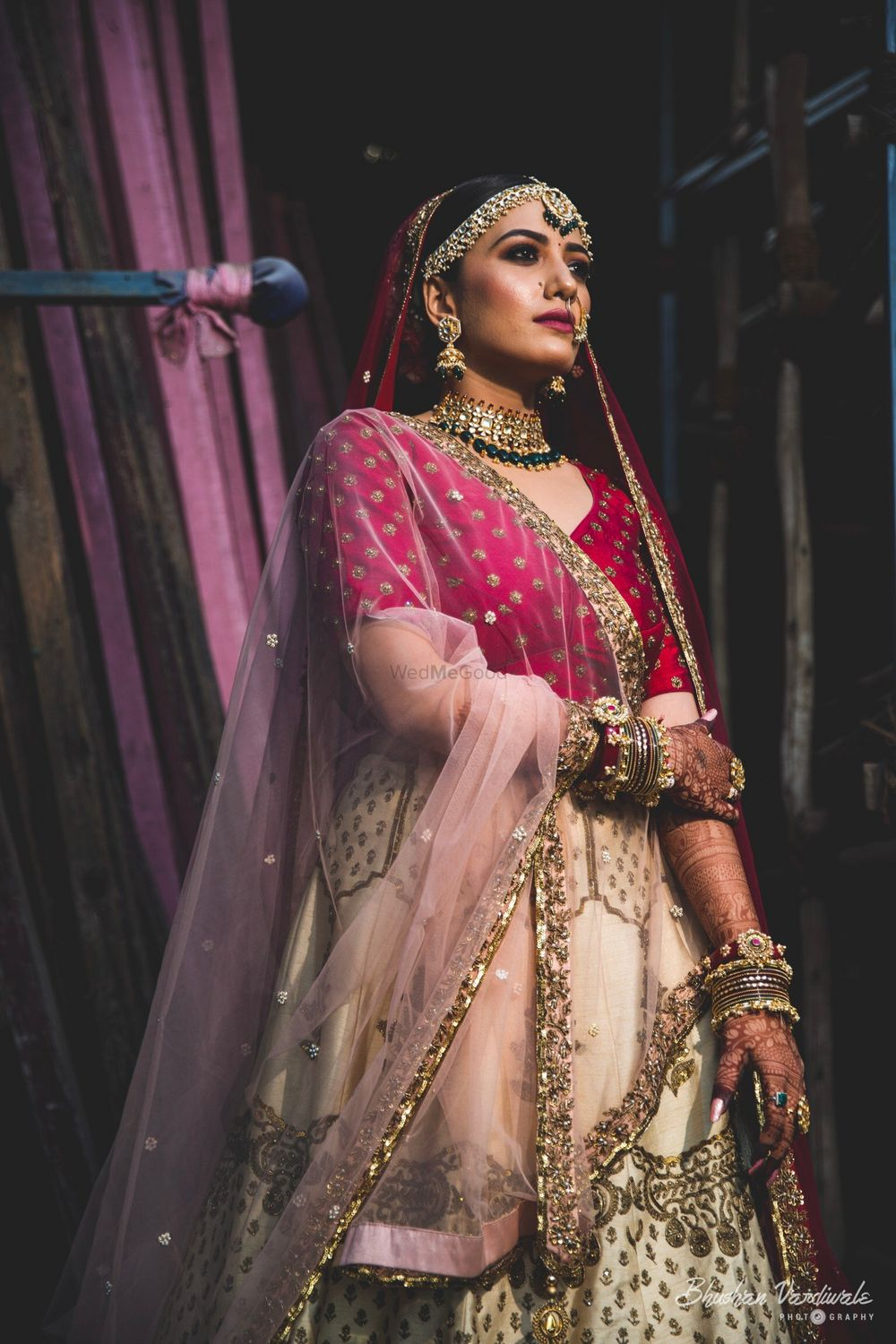 Photo of A bride in red and white lehenga