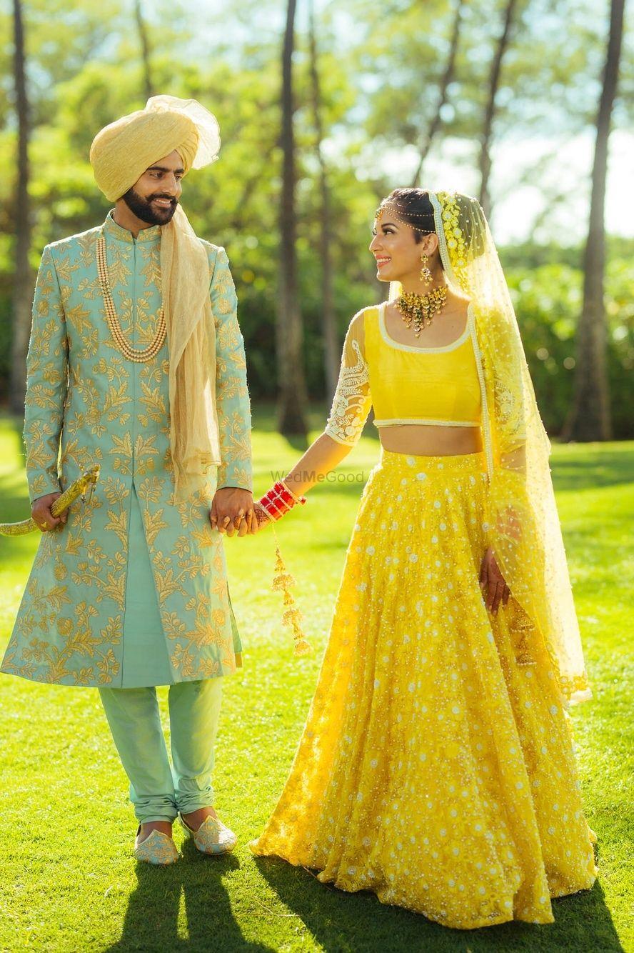 Photo of Yellow bridal lehenga and turqyiuse sherwani
