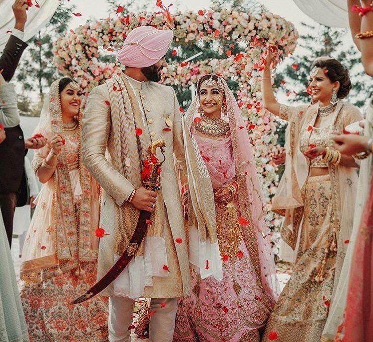 Photo of Light pink theme wedding couple shot from sikh wedding