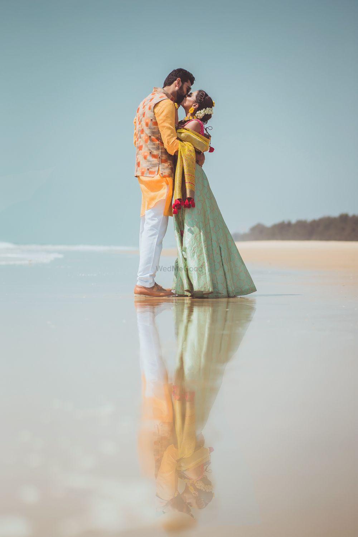 Photo of Couple on beach wedding kissing shot