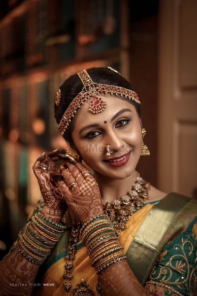 Photo of A happy South Indian bride on her wedding day.