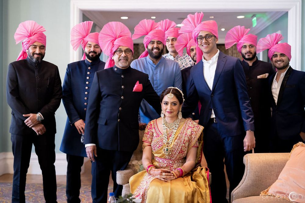 Photo of Bride with bridesmen and father wearing matching safas
