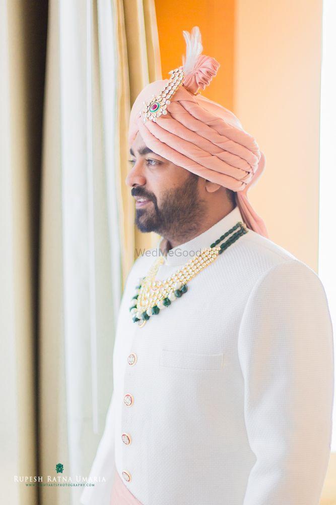 Photo of White Sherwani with Pink Safa and Emerald Necklace