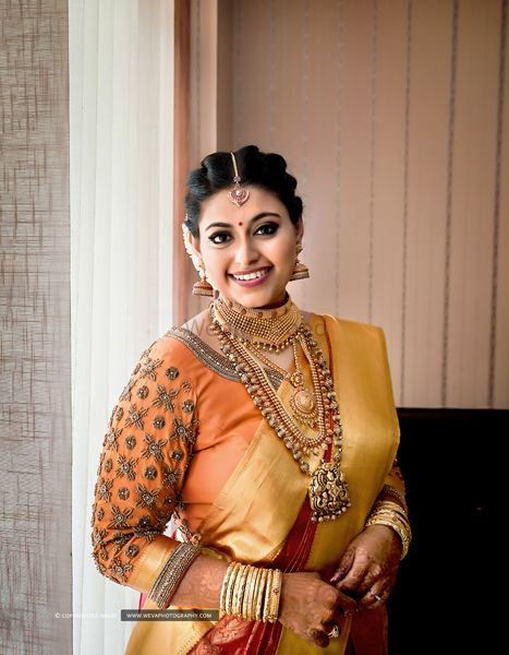 Photo of A south indian bride in a kanjeevaram and gold jewelry!