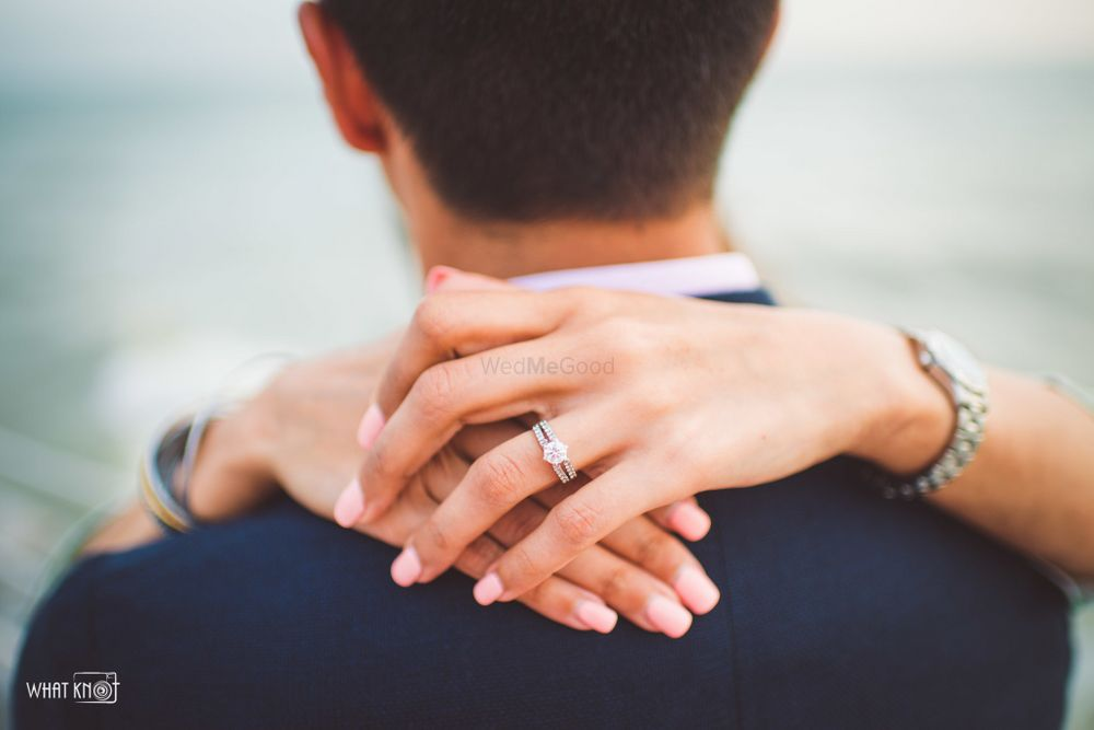 Photo of Engagement announcement with arms around groom