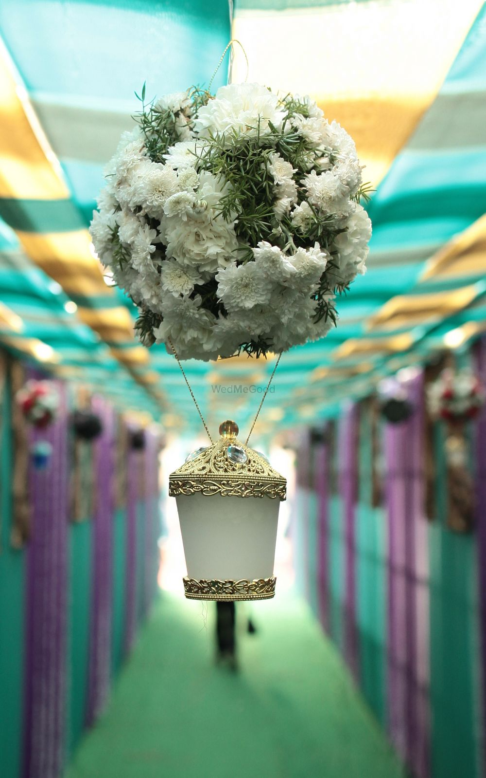 Photo of Hanging White and Gold Floral Decor