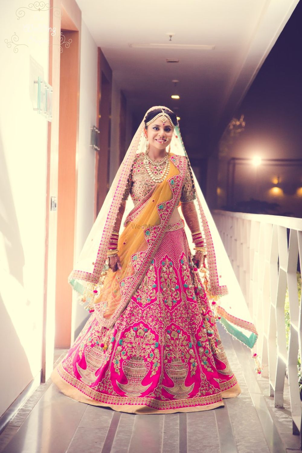 Photo of Pink and mustard yellow bridal lehenga by Anju Modi