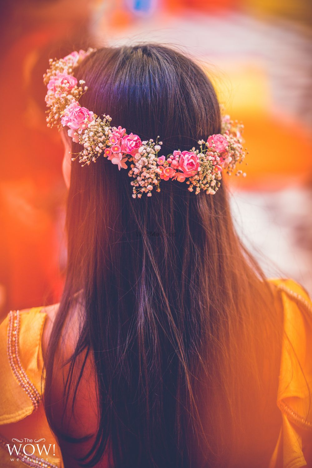 Photo of A bride to be flaunting a floral tiara on her mehndi
