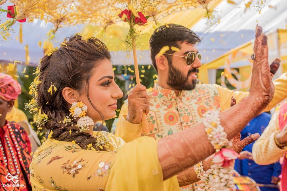 Photo of Mehendi or haldi couple portrait in yellow