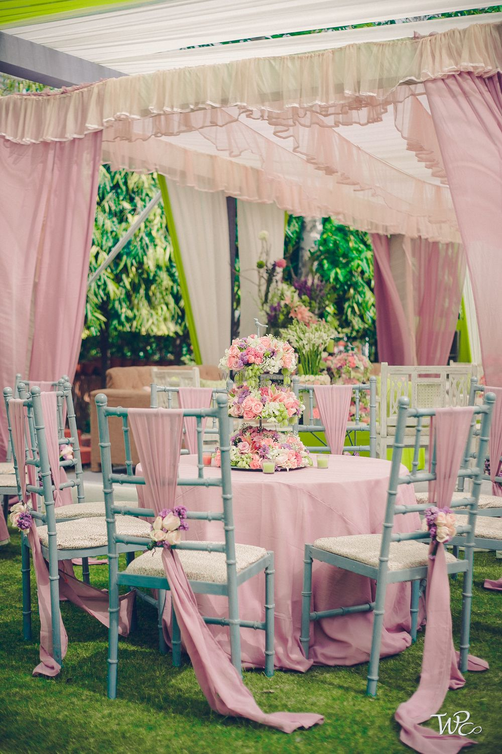 Photo of Soft pink table decor with drapes and flowers