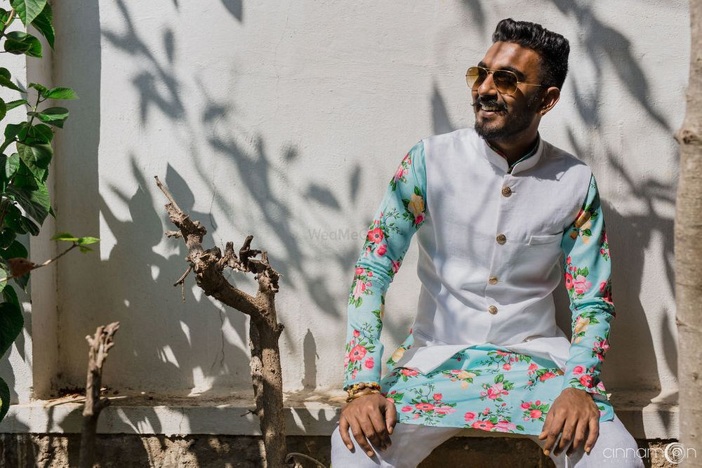Photo of Mehendi groomwear with light blue floral print kurta