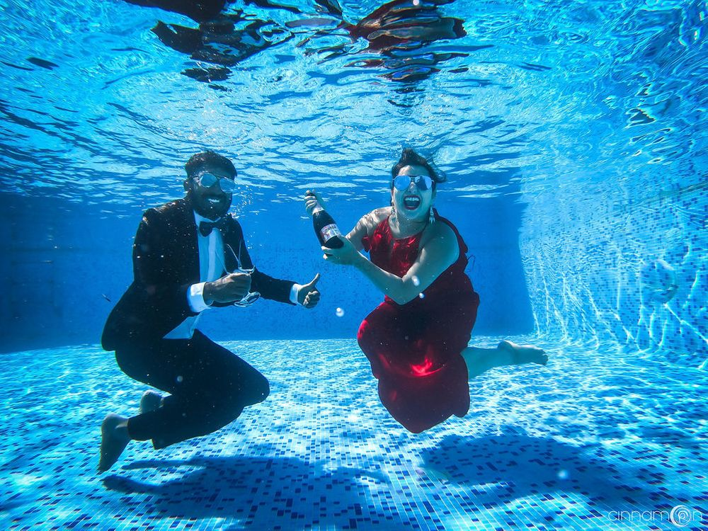 Photo of Cute pre wedding shoot photo idea underwater with champagne