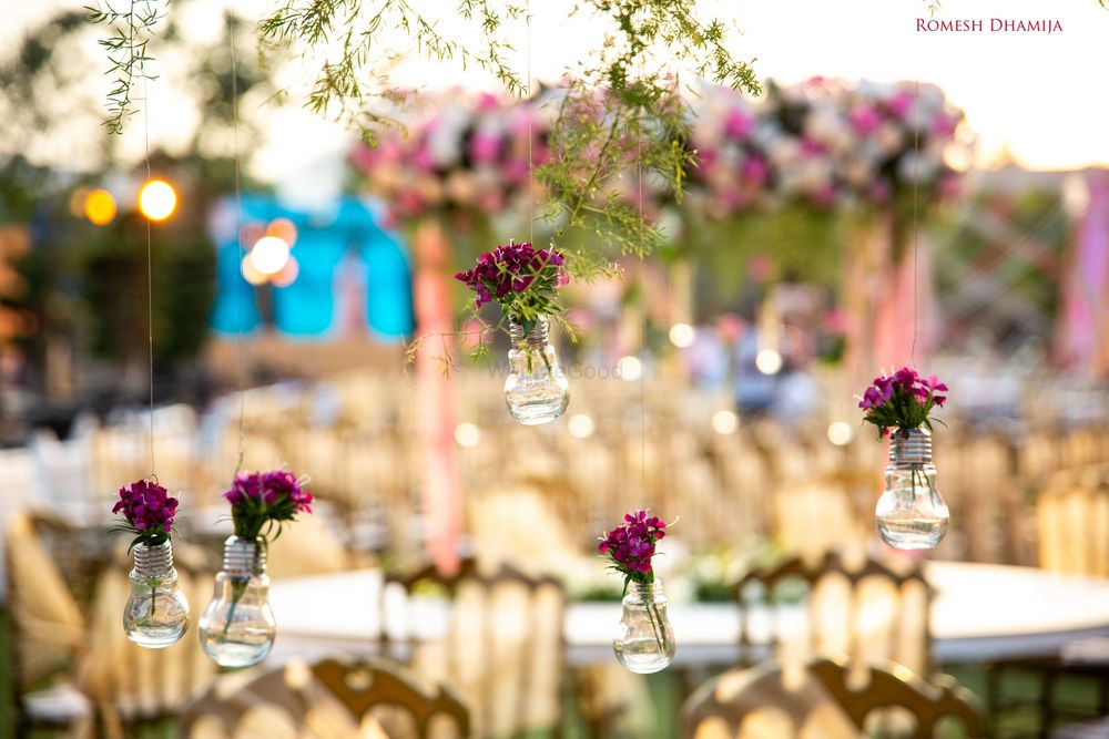 Photo of Hanging bulbs in decor with florals in them for engagement