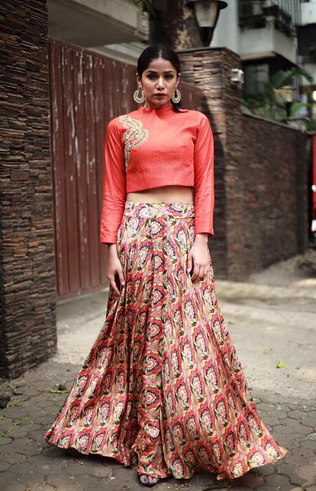 Photo of Coral Blouse and Coral Print Lehenga