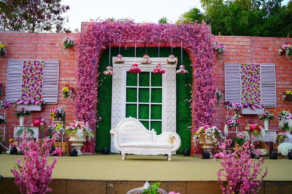 Photo of Engagement floral stage decor idea in pink