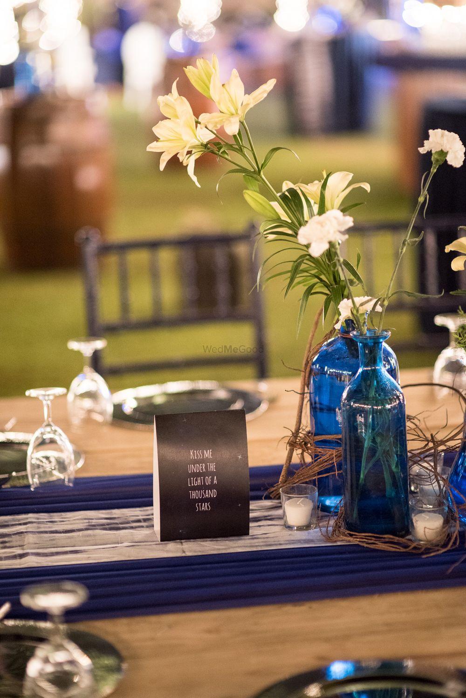 Photo of Flowers in Blue Bottles Decor
