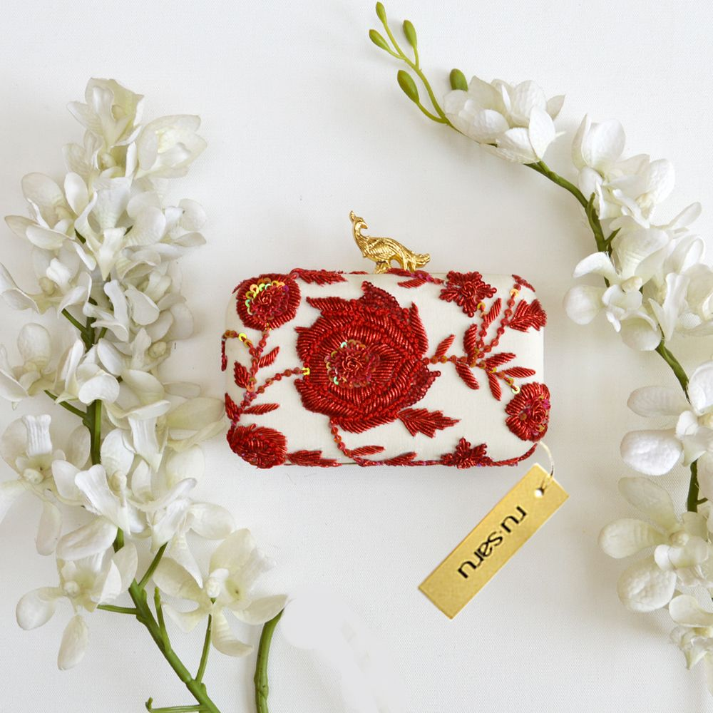 Photo of White and red box clutch for brides