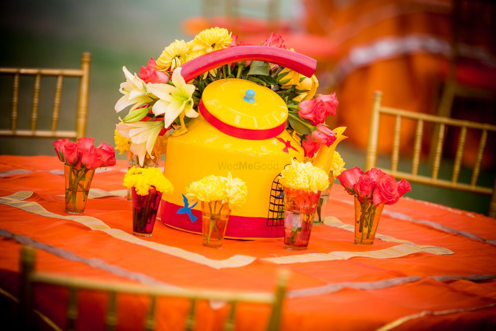 Photo of Teapot and Floral Table Centerpiece