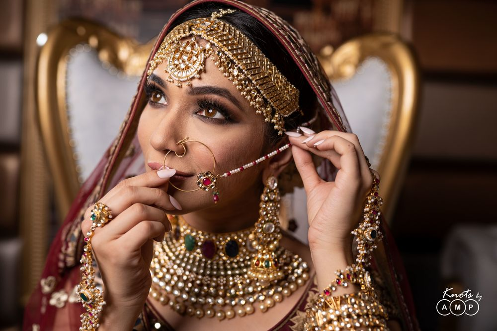 Photo of Heavy bridal mathapatti necklace and earrings with maroon lehenga