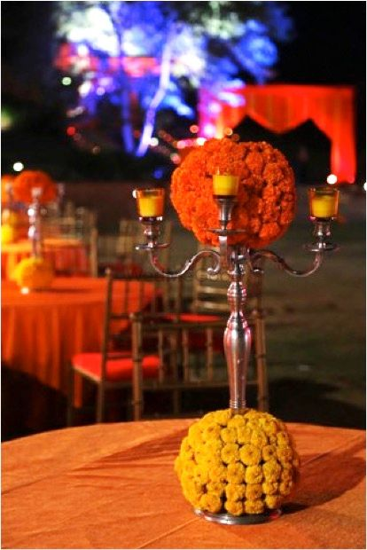 Photo of Silver Candelabras with Genda Phool Table Decor