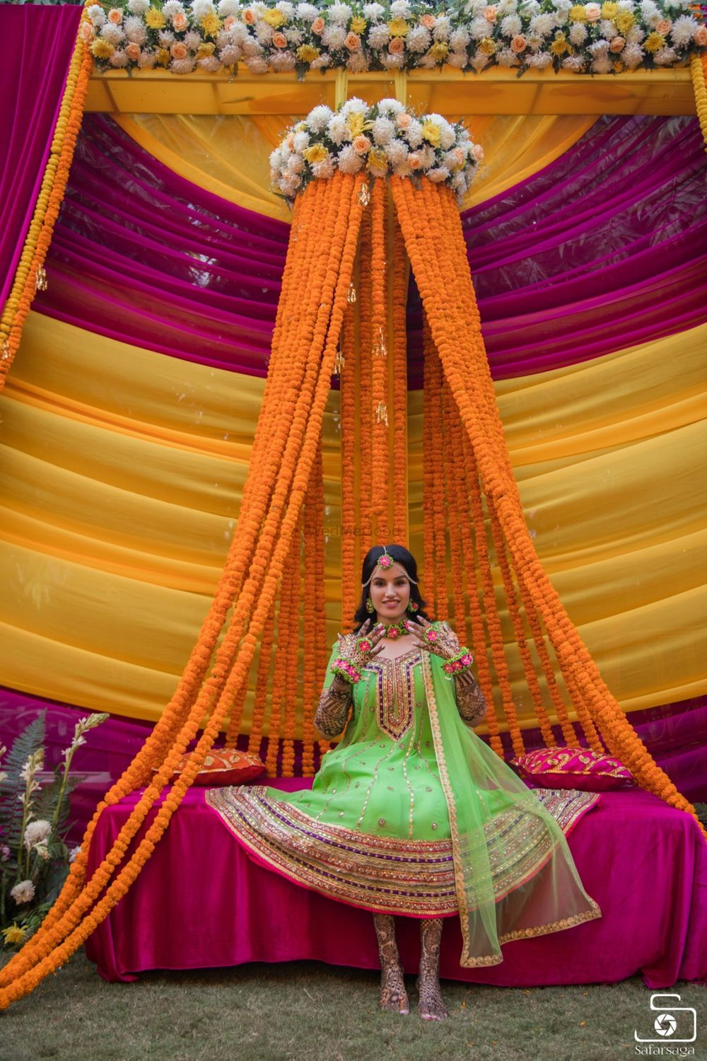 Photo of A bride in a parrot green mehndi outfit