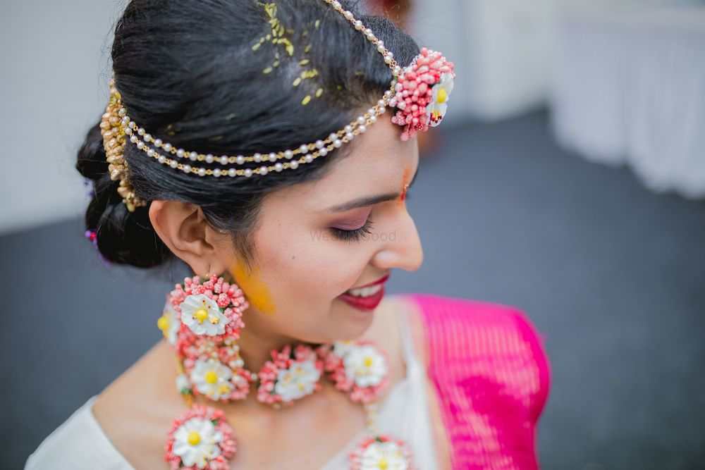 Photo of Pink and white floral jewellery for south indian bride