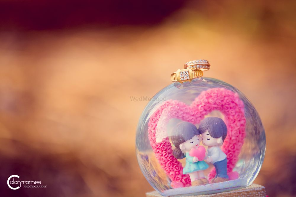 Photo of Engagement Ring on Cute Snow Globe with Couple