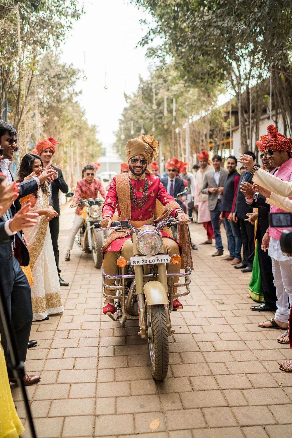 Photo of Groom entering his wedding on a bike