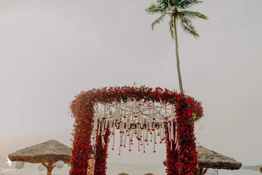 Photo of floral round shaped red mandap