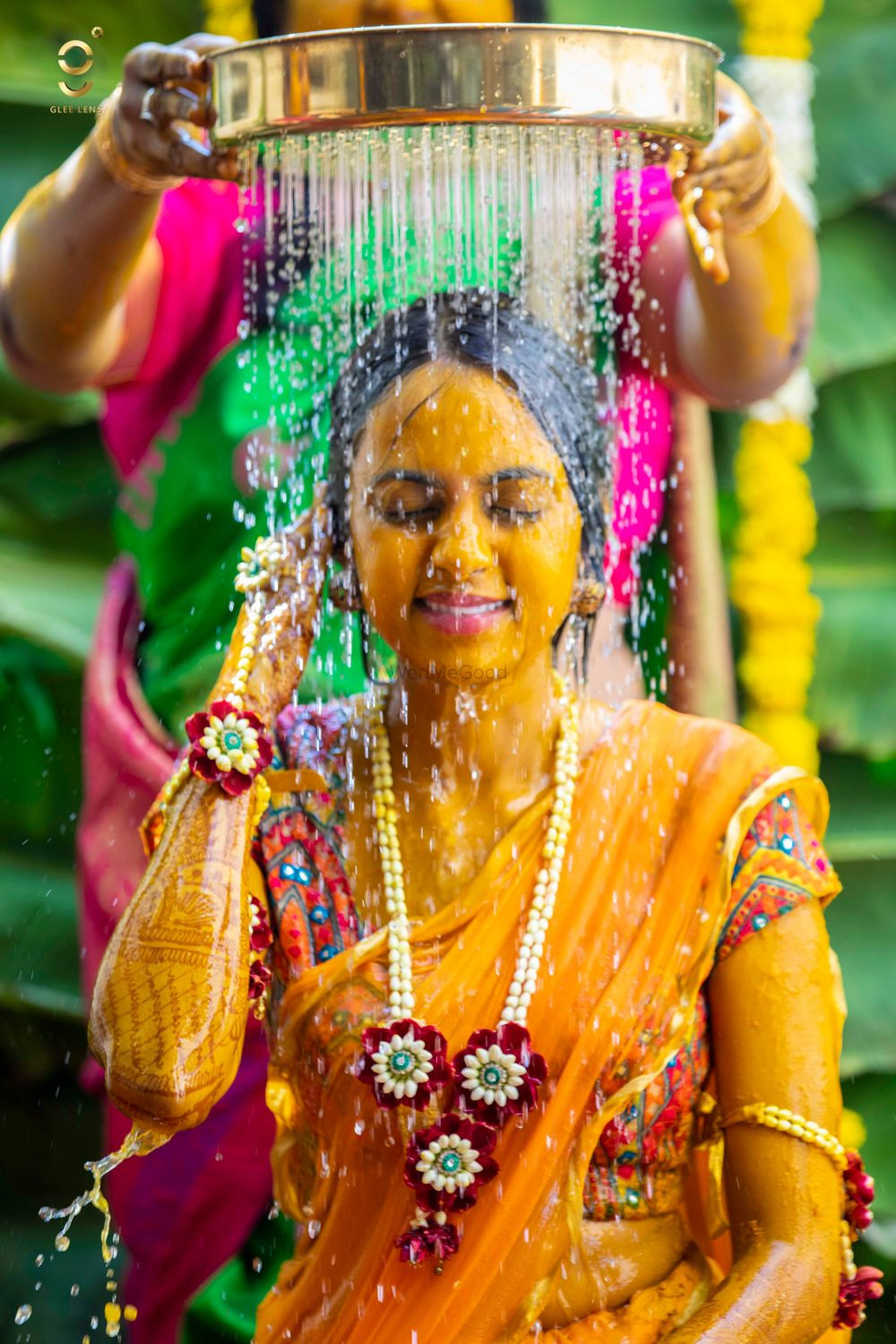 Photo of A south Indian bride on her mehndi in yellow saree