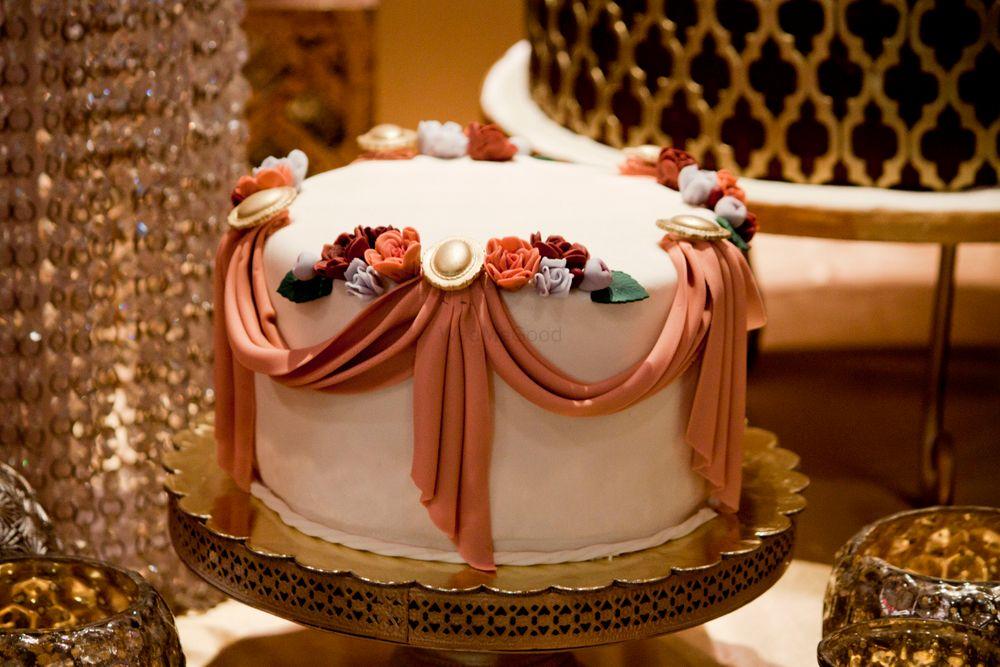 Photo of White and Orange Fondant Wedding Cake