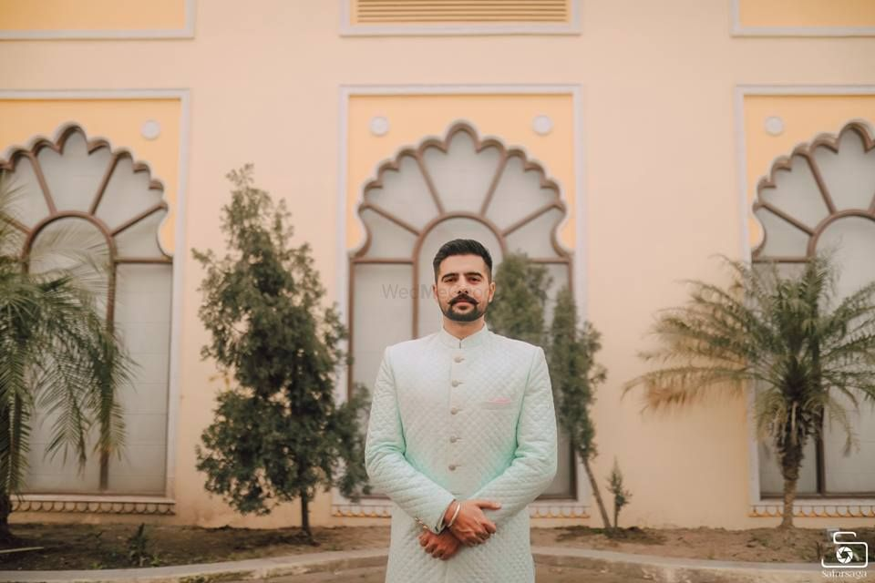 Photo of pastel powder blue sherwani for groom on engagement