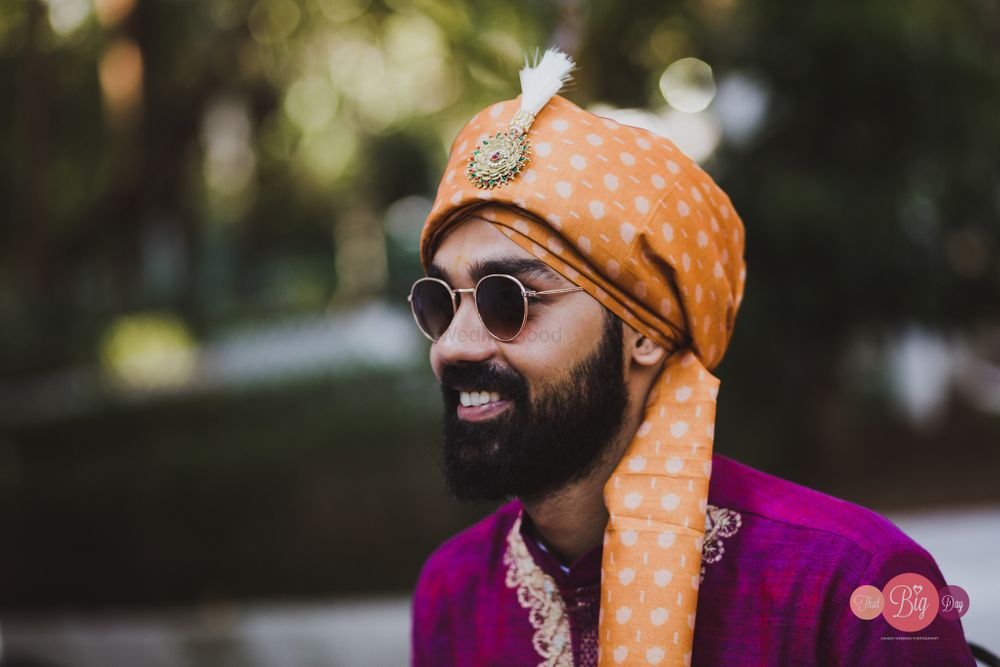 Photo of groom wearing a contrasting peach safa