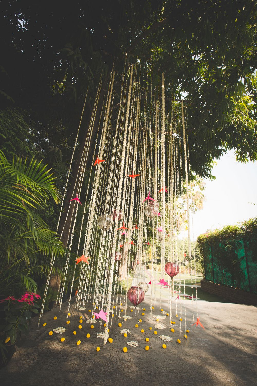 Photo of tree decor idea with hanging floral strings