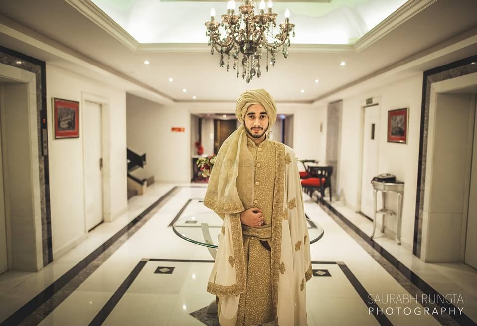Photo of Gold Sequins Sherwani with White and Gold Dupatta