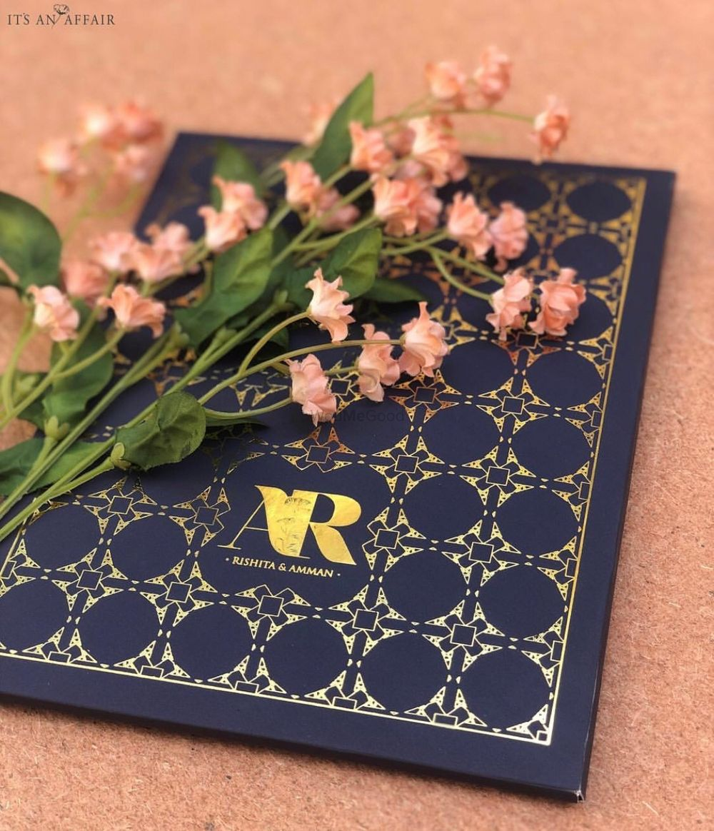 Photo of wedding itinerary or card with couple name logo