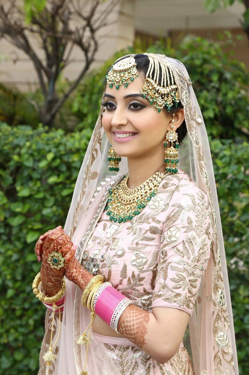 Photo of Gold and green bridal jewellery