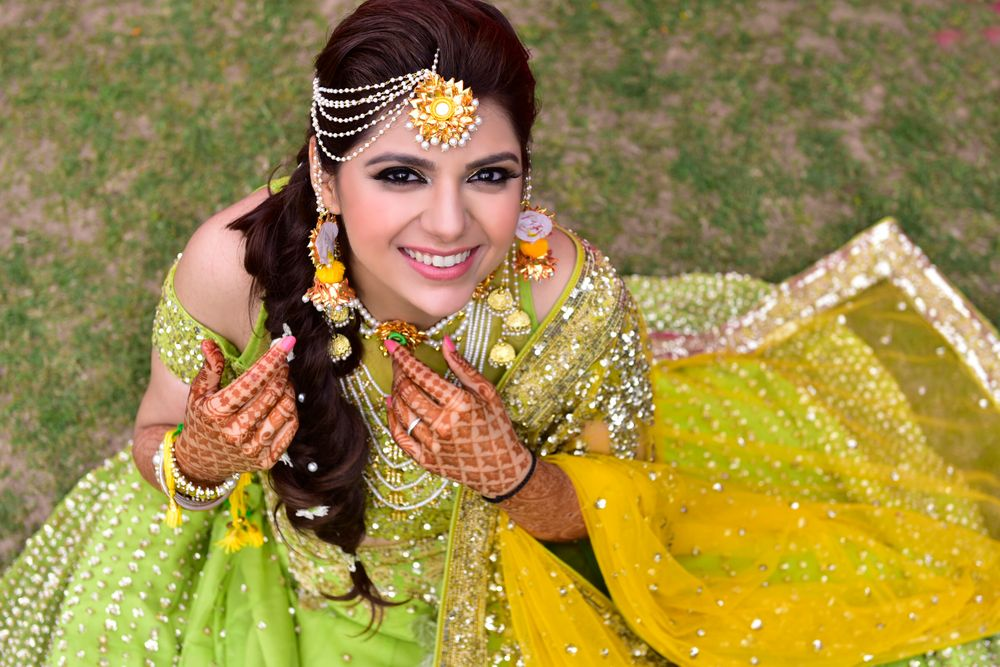 Photo of  Happy Bride to be on mehendi day
