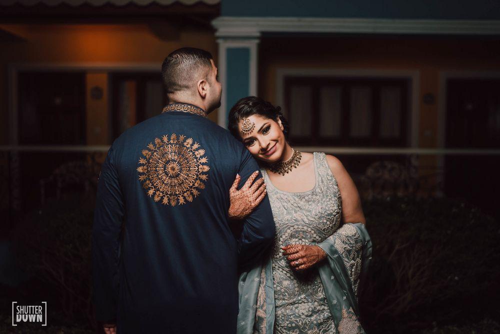 Photo of romantic couple pose idea on sangeet