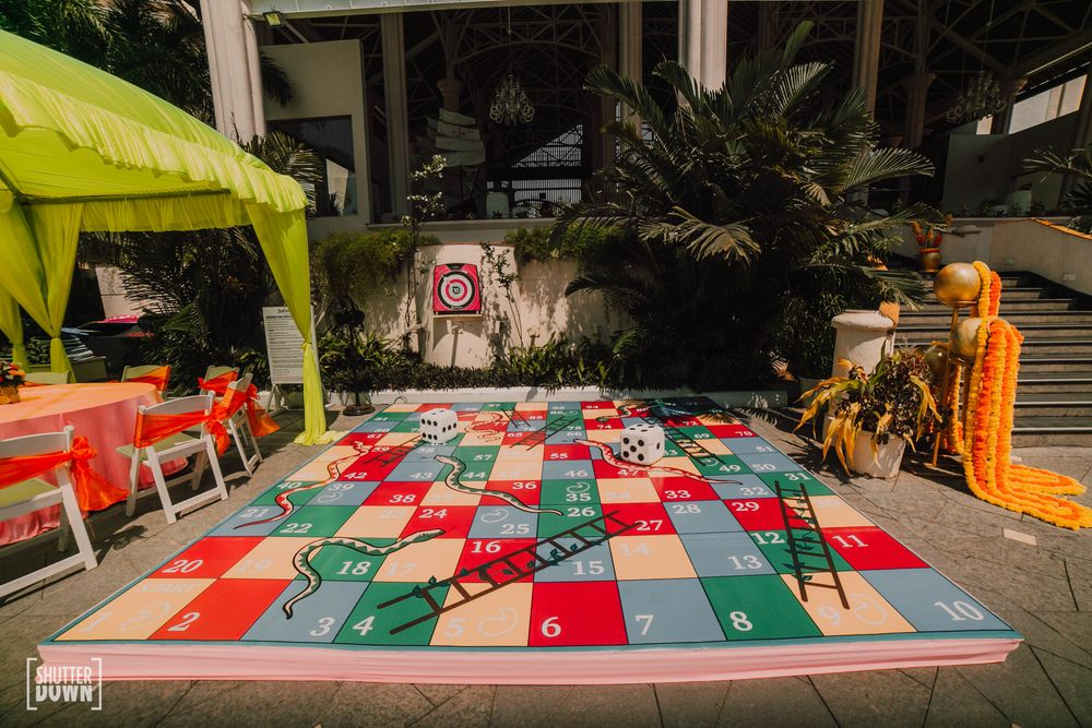 Photo of mehendi game idea with a giant snakes and ladders