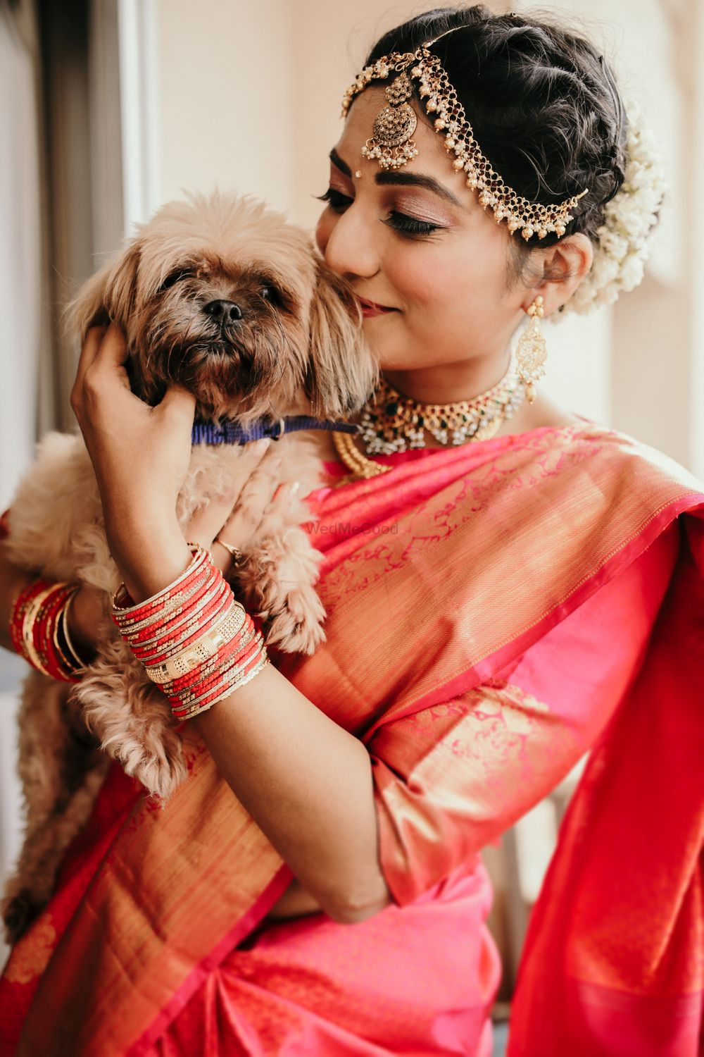 Photo of bride in saree with her dog