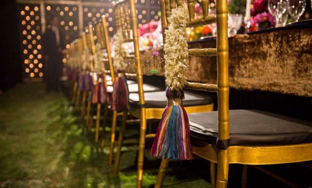 Photo of Chair back decor with flower braid and tassels
