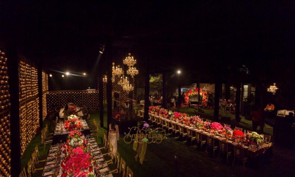 Photo of Night time wedding dinner setup