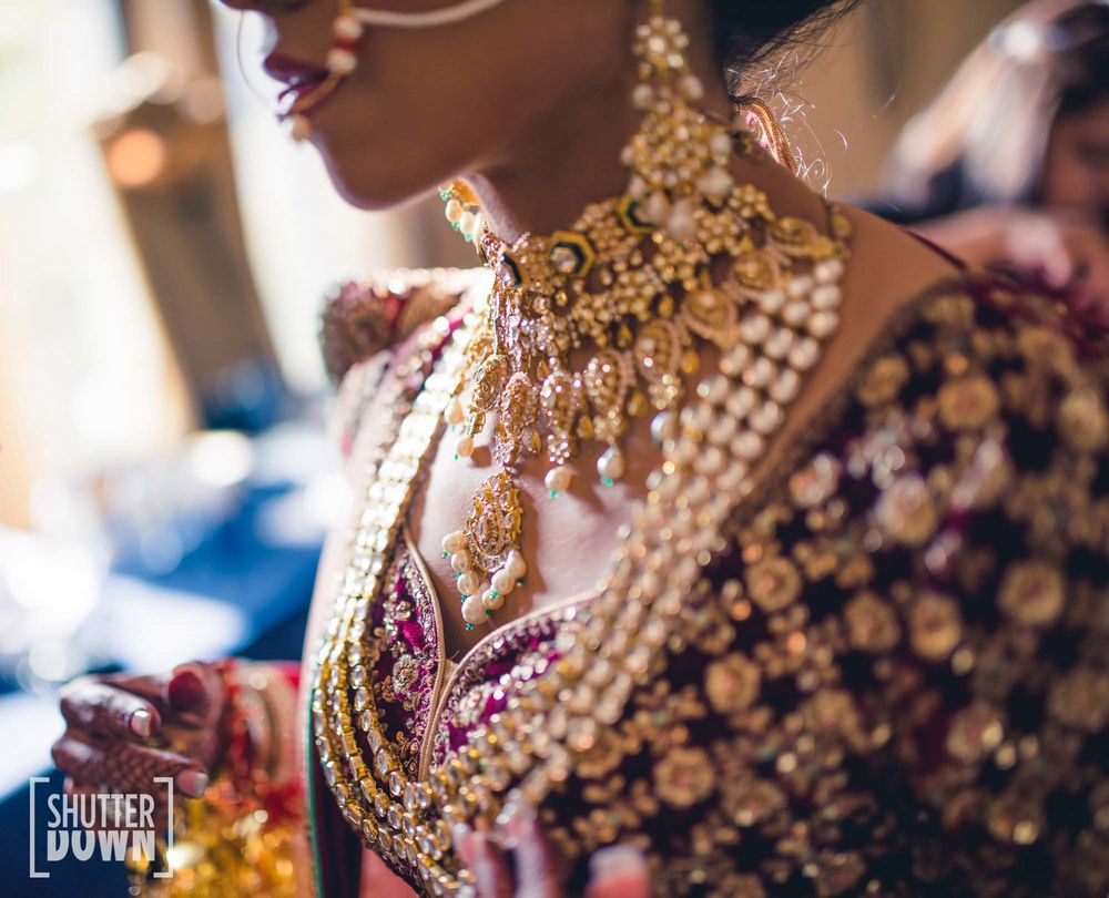 Photo of bridal necklace layering with shorter and rani haar