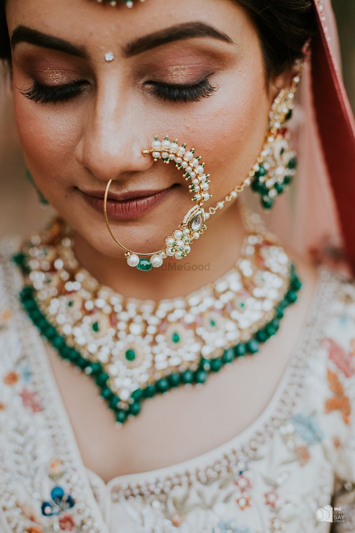 Photo of Beautiful bridal shot in a big pearl Nath.