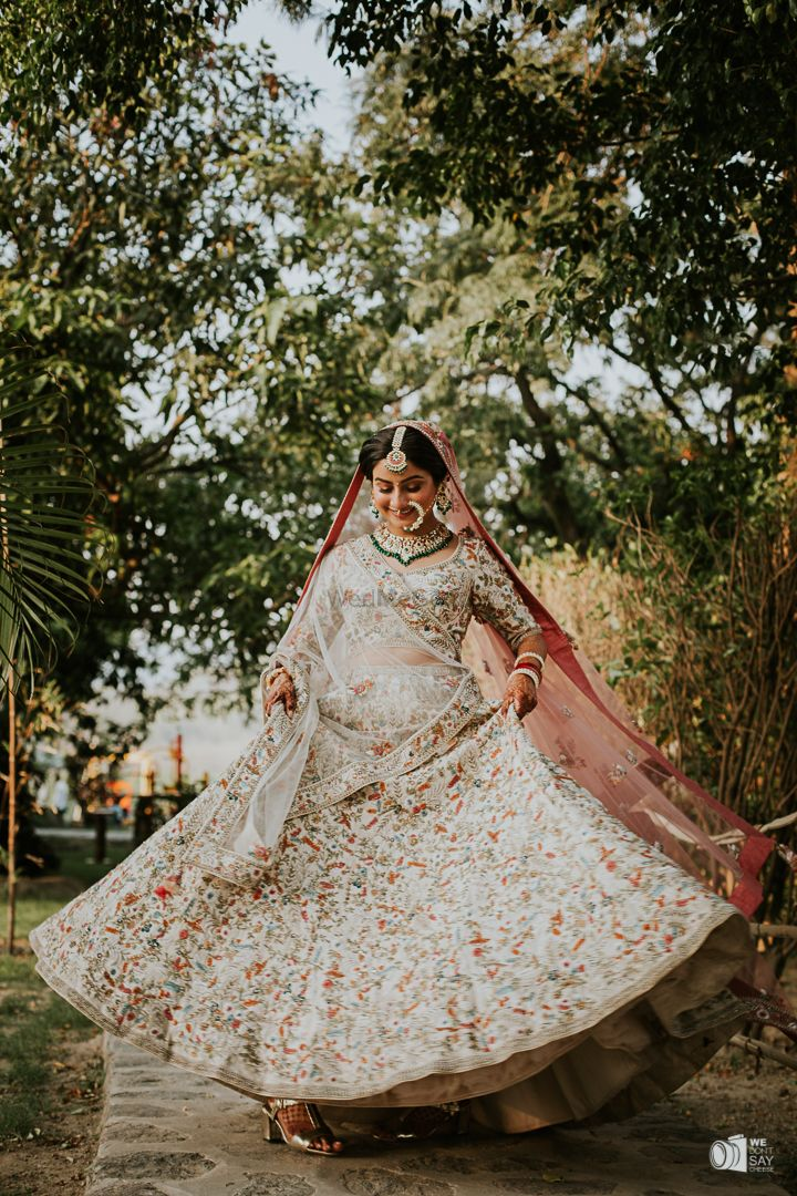 Photo of A happy twirling bridal shot.